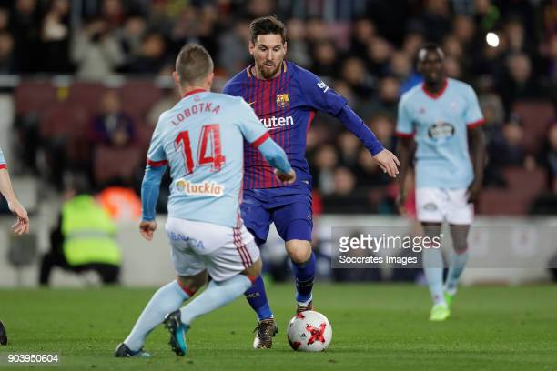 Stanislav Lobotka of Valencia CF Lionel Messi of FC Barcelona during the Spanish Copa del Rey match between FC Barcelona v Celta de Vigo at the Camp...
