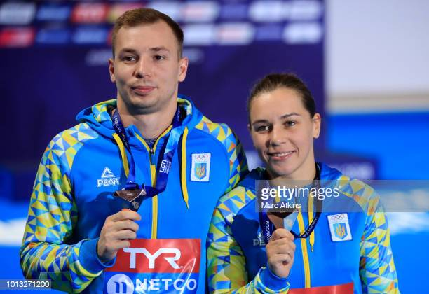 Stanislav Oliferchyk and Viktoriya Kesar of Ukraine pose with their Bronze Medals after the Mixed Synchronised 3m Springboard final during the diving...