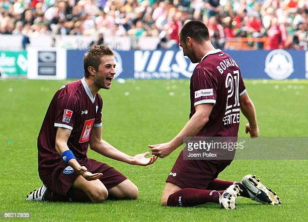 Stanislav Sestak of Bochum celebrates with his team mate Marc Pfertzel after scoring his team's first goal during the Bundesliga match between Werder...