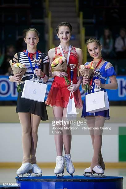 Stanislava Konstantinova Polina Tsurskaya and Elizaveta Nugumanova of Russia pose during the Junior Ladies medal ceremony on day three of the ISU...