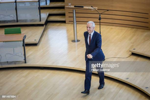 Stanislaw Tillich CDU former prime minister of the German state of Saxony goes through the plenay hall of the Landtag of Saxony on December 13 2017...