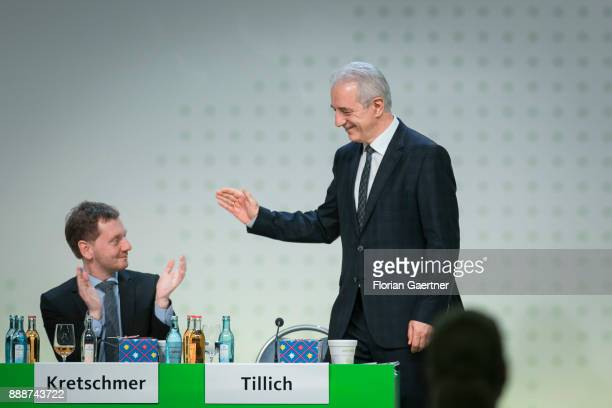 Stanislaw Tillich CDU prime minister of the German state of Saxony gestures to Michael Kretschmer designated prime minister of the German State of...