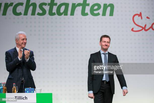 Stanislaw Tillich CDU prime minister of the German state of Saxony claps his hands after the election of Michael Kretschmer designated prime minister...