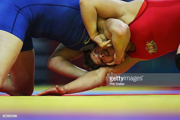 Stanka Zlateva of Bulgaria competes against Maider Unda of Spain in the Women's FR 72 kg Quarterfinal held at the China Agriculture University...