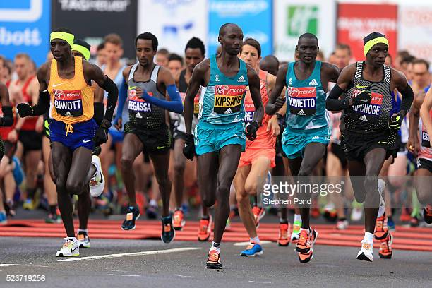 Stanley Biwott Wilson Kipsang Dennis Kimetto and Eliud Kipchoge of Kenya start during the Virgin Money London Marathon on April 24 2016 in London...