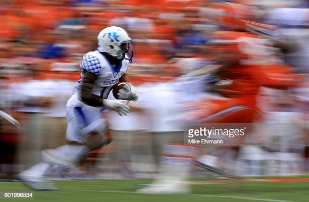 Stanley Boom Williams of the Kentucky Wildcats rushes during a game against the Florida Gators at Ben Hill Griffin Stadium on September 10, 2016 in...