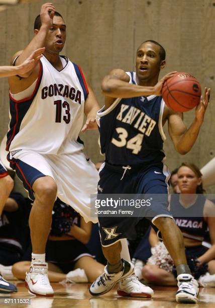 Stanley Burrell of the Xavier Musketeers looks to pass against JP Batista of the Gonzaga Bulldogs during the First Round of the 2006 NCAA Men's...