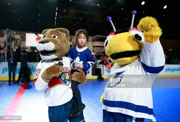 Stanley C Panther of the Florida Panthers and Fin the Whale of the Vancouver Canucks participate in the 2019 NHL AllStar Mascot Showdown on January...