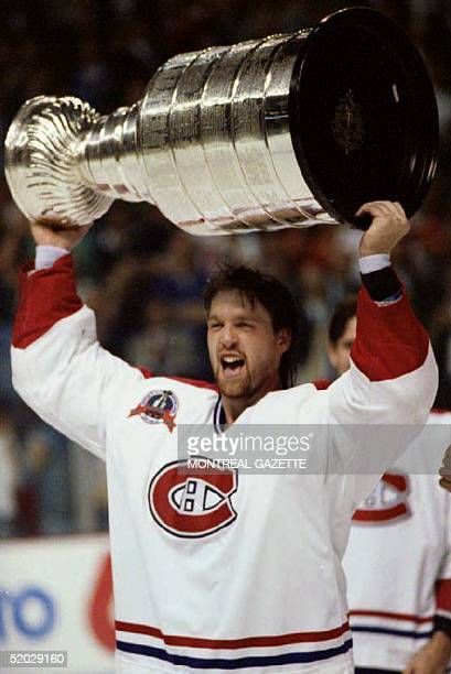 Stanley Cup Most Valuable Player Patrick Roy of the Montreal Canadiens holds the cup over his head after Montreal defeated the Los Angeles Kings 41...