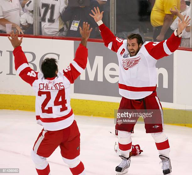 Stanley Cup Playoff MVP, Henrik Zetterberg of the Detroit Red Wings celebrates with teammate Chris Chelios after defeating the Pittsburgh Penguins in...