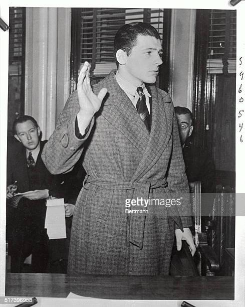 Stanley F Tomaszewski busboy employed at Cocoanut Grove is sworn in prior to testifying at a hearing at fire headquarters Tomaszewski who is a model...