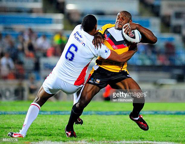 Stanley Gene of Papua New Guinea is tackled by Leon Pryce of England during the 2008 Rugby League World Cup Pool 1 match between England and Papua...