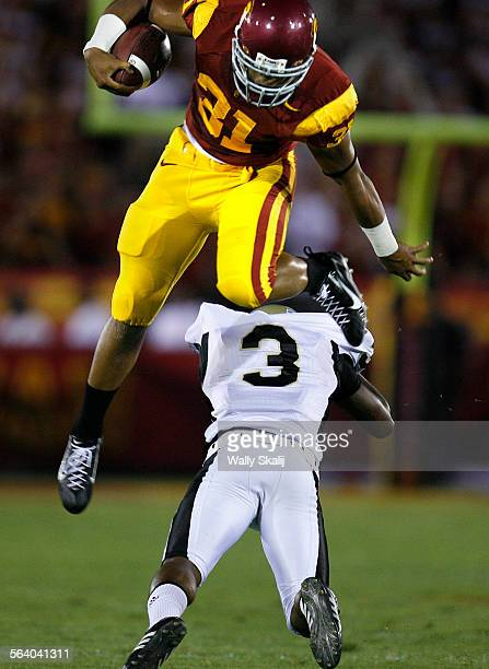 USC Stanley Havili is upended by Idaho's Breyon Williams after a gain in the first quarter at the Coliseum Saturday