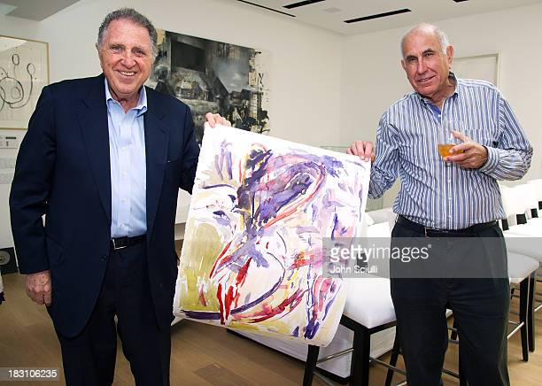 Stanley Hollander and Michael Hort with an artwork by Jon Pestoni attend the Rema Hort Mann Foundation conversation with Susan and Michael Hort on...