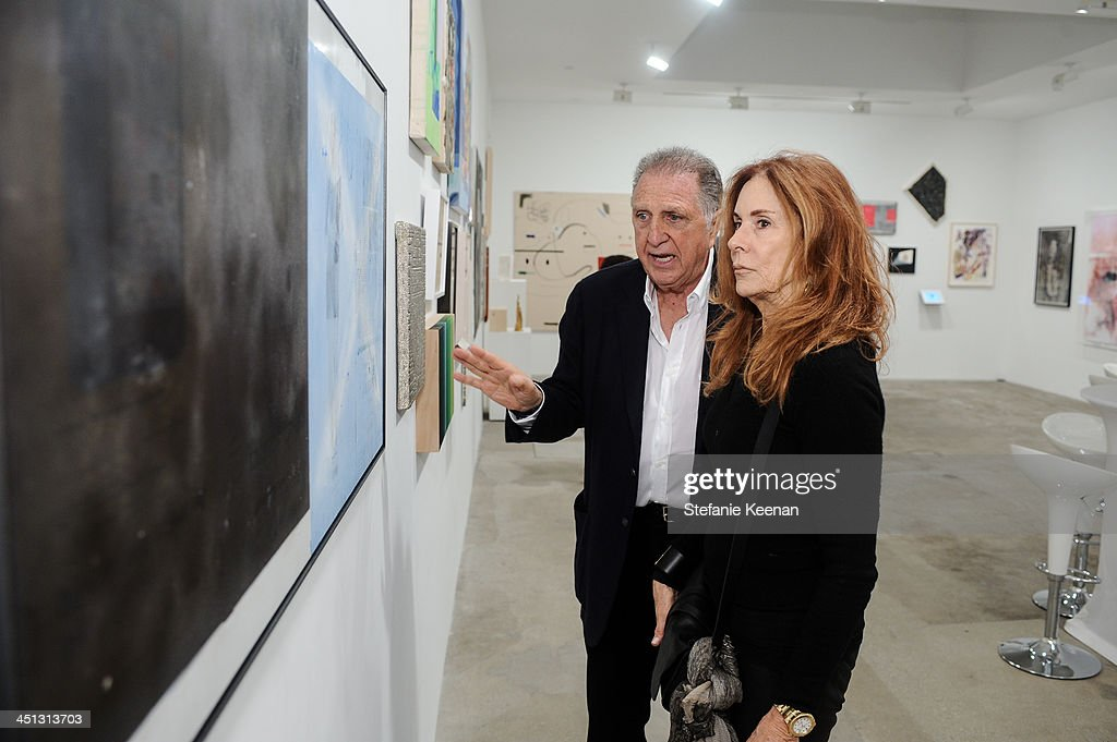Stanley Hollander and Pamerla Robinson attend The Rema Hort Mann Foundation LA Artist Initiative Benefit Auction on November 21, 2013 in Los Angeles, California.