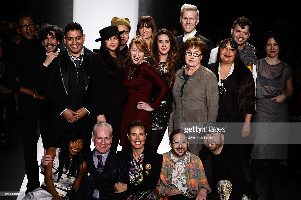 Stanley Hudson, Daniel Esquivel, James Martinez, Layana Aguilar, Tu Suthiwat Nakchat, Kate Pankoke, Amanda Valentine, Emily Pollard, Benjamin Mach, Cindy Marlatt, Patricia Michaels, Matthew Arthur, Michelle Lesniak Franklin, (sitting, L-R) Samantha Black, Tim Gunn, Heidi Klun, Joseph Aaron Segal, and Richard Hallmarq pose on the runway at the Project Runway Fall 2013 fashion show during Mercedes-Benz Fashion Week at The Theatre at Lincoln Center on February 8, 2013 in New York City.