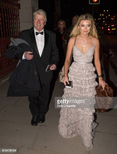 Stanley Johnson father of Boris Johnson and Georgia Toffolo reality TV star arrive for the Conservative party Black and White Ball at Natural History...