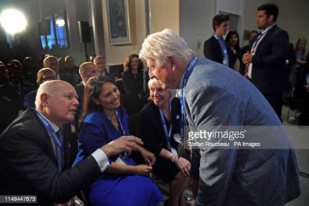 Stanley Johnson father of Boris Johnson speaks with Conservative MPs Iain Duncan Smith Priti Patel and Nadine Dorries as Boris Johnson launches his...