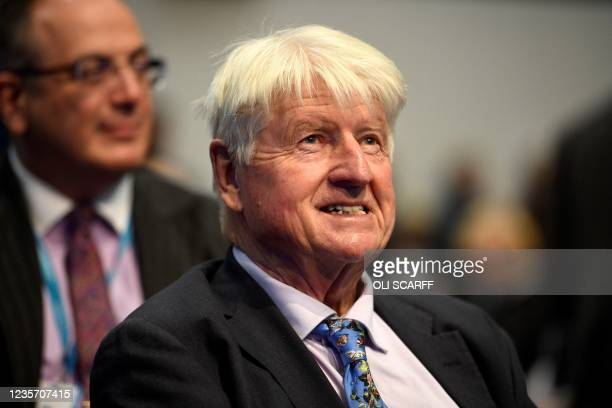 Stanley Johnson, father of Britain's Prime Minister Boris Johnson, listens to a speaker on the third day of the annual Conservative Party Conference...