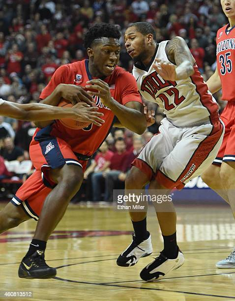 Stanley Johnson of the Arizona Wildcats drives against Jelan Kendrick of the UNLV Rebels during their game at the Thomas Mack Center on December 23...