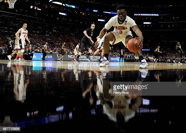 Stanley Johnson of the Arizona Wildcats grans the ball in the corner against the Xavier Musketeers in the second half during the West Regional...