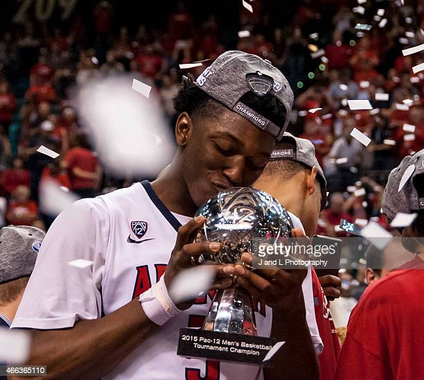 Stanley Johnson of the Arizona Wildcats kisses the championship trophy after beating the Oregon Ducks to win the championship game of the Pac12...