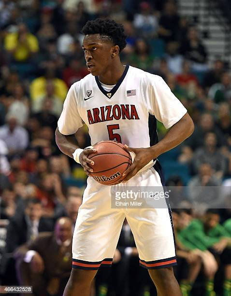 Stanley Johnson of the Arizona Wildcats looks to pass against the Oregon Ducks during the championship game of the Pac12 Basketball Tournament at the...