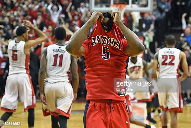 Stanley Johnson of the Arizona Wildcats pulls his jersey up and walks toward his bench after turning the ball over in the final seconds of the team's...