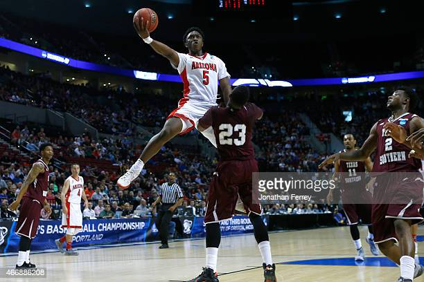 Stanley Johnson of the Arizona Wildcats puts up a shot over Jason Carter of the Texas Southern Tigers in the first half during the second round of...