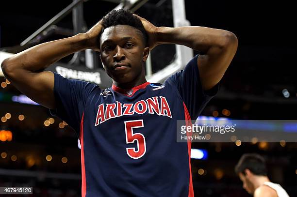 Stanley Johnson of the Arizona Wildcats reacts after called for a foul in the second half against the Wisconsin Badgers during the West Regional...