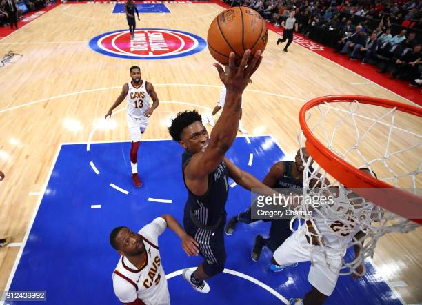 Stanley Johnson of the Detroit Pistons drives to the basket past Dwyane Wade of the Cleveland Cavaliers during the first half at Little Caesars Arena...