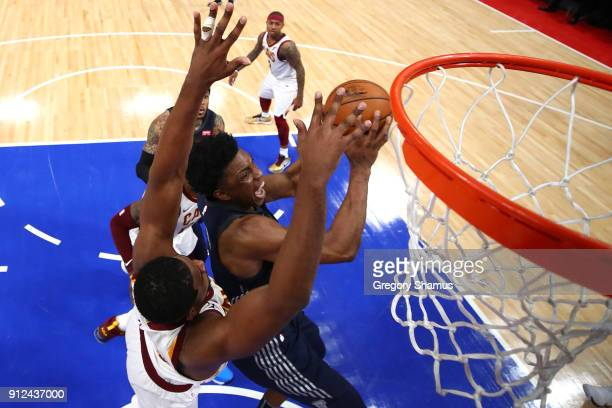 Stanley Johnson of the Detroit Pistons drives to the basket past Tristan Thompson of the Cleveland Cavaliers during the first half at Little Caesars...