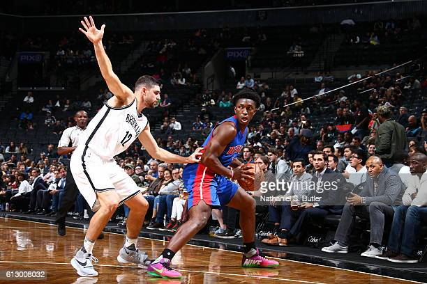 Stanley Johnson of the Detroit Pistons handles the ball against Joe Harris of the Brooklyn Nets on October 6 2016 at Barclays Center in the Brooklyn...
