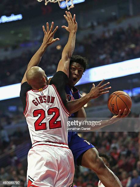 Stanley Johnson of the Detroit Pistons tires to get off a shot around Taj Gibson of the Chicago Bulls during a preseason game at the United Center on...