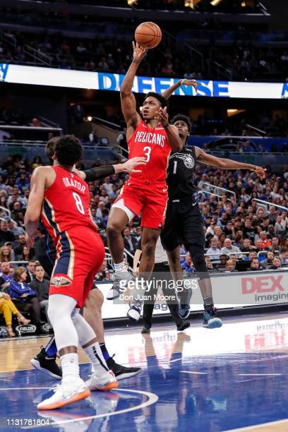Stanley Johnson of the New Orlean Pelicans drive pass Jonathan Isaac of the Orlando Magic during the game at the Amway Center on March 20 2019 in...