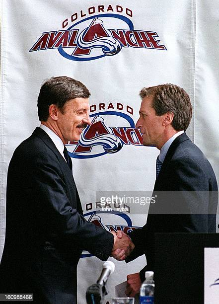 E Stanley Kroenke Vice Chairman of the Super Bowl Champion St Louis Rams shakes hands with Gary Howard President Ceo Liberty Media Corporation...