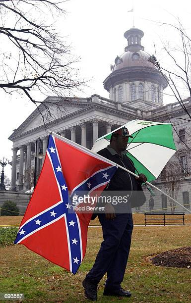 Stanley Lott of Saluda SC joins other Confederate flag supporters as they counteract a protest by members of the NAACP calling for the removal of the...