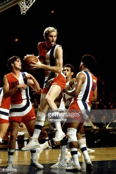 Stanley Love of the Baltimore Bullets rebounds against the Milwaukee Bucks during the 1971 season at the MECCA Arena in Milwaukee Wisconsin NOTE TO...