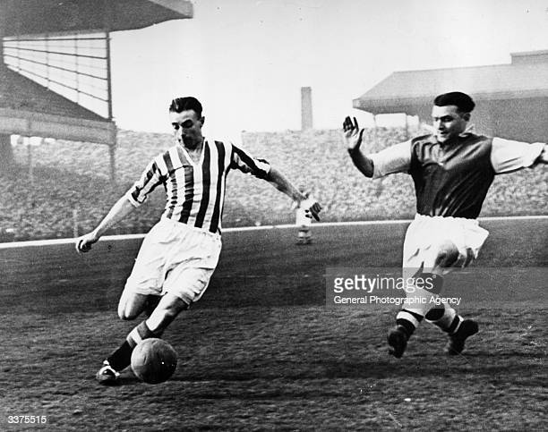 Stanley Matthews playing for Stoke City FC beats the opposition's defence