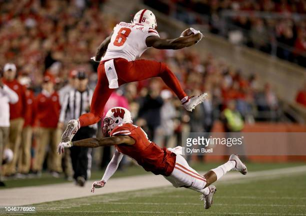 Stanley Morgan Jr #8 of the Nebraska Cornhuskers leaps over Deron Harrell of the Wisconsin Badgers in the second quarter at Camp Randall Stadium on...