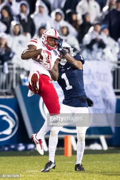 Stanley Morgan Jr #8 of the Nebraska Cornhuskers makes a leaping catch during the third quarter as Christian Campbell of the Penn State Nittany Lions...