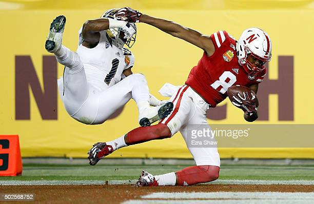 Stanley Morgan Jr #8 of the Nebraska Cornhuskers makes a onehanded touchdown catch while covered by Ishmael Adams of the UCLA Bruins during the...