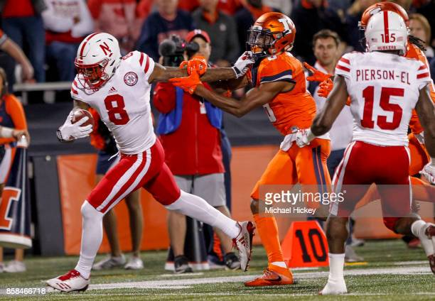 Stanley Morgan Jr #8 of the Nebraska Cornhuskers runs the ball into the end zone as Nate Hobbs of the Illinois Fighting Illini tries to make the stop...
