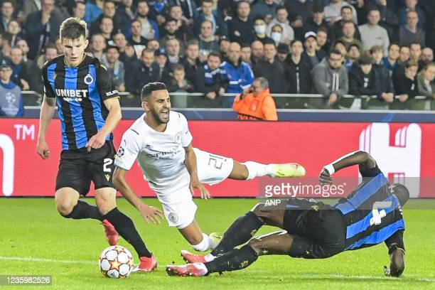 Stanley Nsoki of Club Brugge fouls Riyad Mahrez of Manchester City FC during the UEFA Champions League match between Club Brugge and Manchester City...