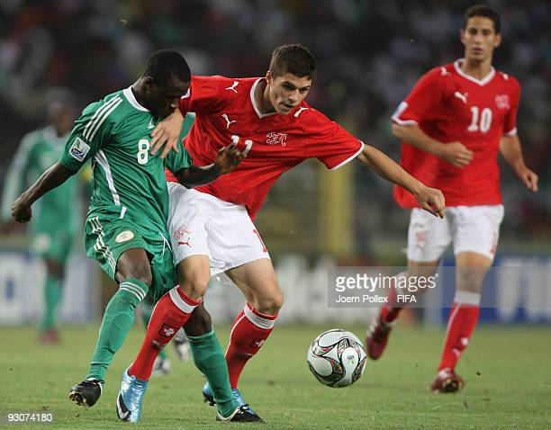 Stanley Okoro of Nigeria and Granit Xhaka of Switzerland battle for the ball during the FIFA U17 World Cup Final between Switzerland and Nigeria at...