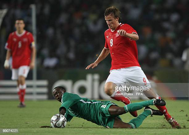 Stanley Okoro of Nigeria and Haris Seferovic of Switzerland battle for the ball during the FIFA U17 World Cup Final between Switzerland and Nigeria...