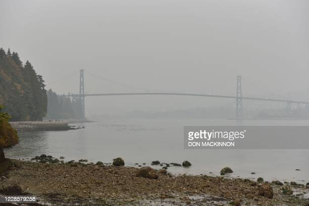 Stanley Park and Lions Gate Bridge are covered in smog from clouds and smoke due to forest fires in Washington, Oregon and California, September 17...