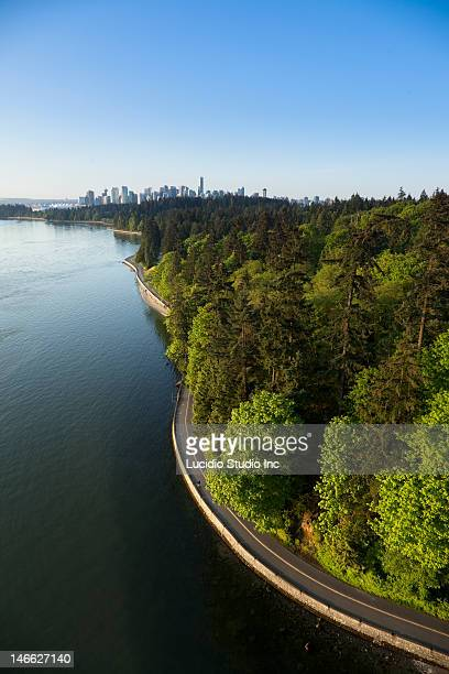 stanley park and vancouver skyline - stanley park vancouver canada stock pictures, royalty-free photos & images