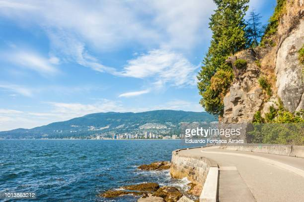 stanley park - english bay stock photos and pictures