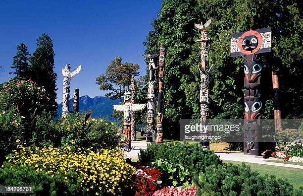 stanley park totem pole vancouver - totem pole stock photos and pictures